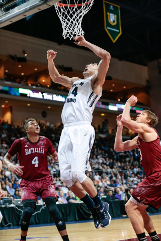 BYU center Corbin Kaufusi (44) leaps for another rebound, while defenders Santa Clara guard Jarvis Pugh (4) and Santa Clara forward Nate Kratch (43) watch for the ball during second half of the We ...