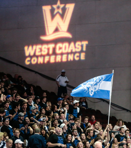BYU fans wave a flag waves in support of their team during second half of the Western Athletic Conference Championship tournament Quarterfinal 4: BYU vs. Santa Clara at the Orleans Arena in Las Ve ...