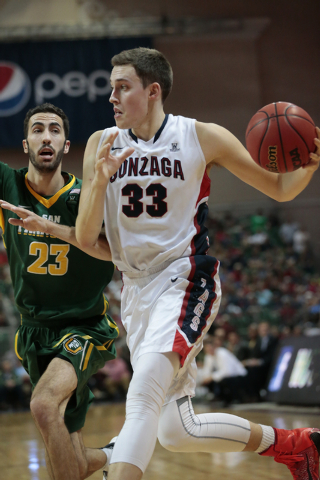 Gonzaga University forward Kyle Wiltjer(cq) (33) moves the ball towards the basket while being defended by San Francisco Dons center Mark Tollefsen (23)  during the second half of the Western Athl ...