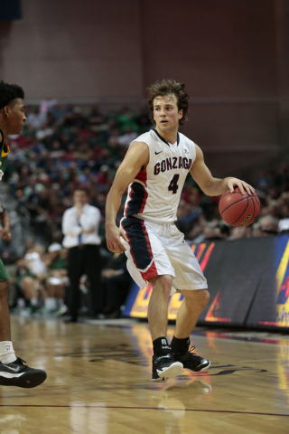 Gonzaga University guard Kevin Pangos (4) looks for an open team member while moving the ball during the second half of the Western Athletic Conference Championship tournament Quarterfinal 3: Gonz ...