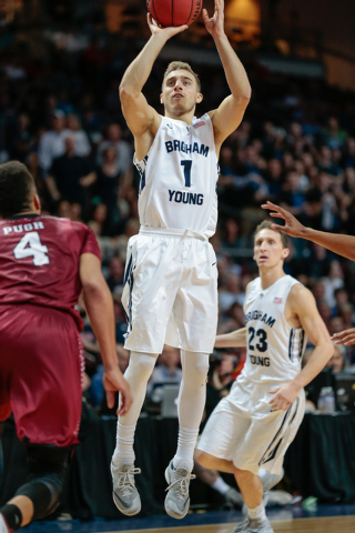 BYU guard Chase Fischer( 1) shoots for a three pointer, as team mate BYU guard Skyler Halford (23) watches in the background, during second half of the Western Athletic Conference Championship tou ...