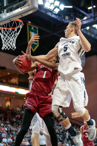 Santa Clara forward Evan Wardlow (1) holds on to a rebound, while BYU guard Kyle Collinsworth (5) attempts to pull it away, during second half of the Western Athletic Conference Championship tourn ...