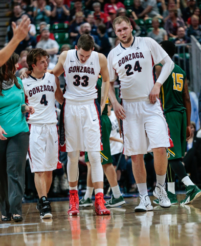 Gonzaga University forward Kyle Wiltjer (33) center, is helped off the court by Gonzaga University guard Kevin Pangos (4), and Gonzaga University center Przemek (cq) Karnowski(cq) (24) during seco ...
