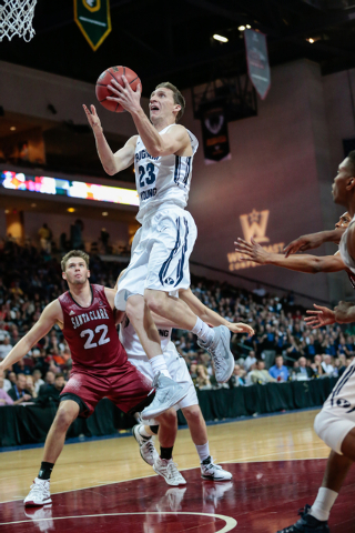 BYU guard Skyler Halford(23) leaps high towards the basket as defender Santa Clara forward Matt Hubbard (22) looks on, during second half of the Western Athletic Conference Championship tournament ...