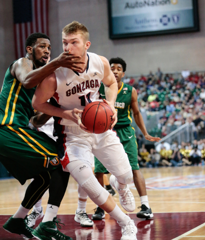 Gonzaga University forward Domantas Sabonis (11) catches a hand to his face by San Francisco Dons guard Matt Glover (5), during second half of the Western Athletic Conference Championship tourname ...