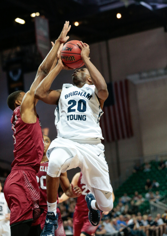 BYU guard Anson Winder( 20) shoots for a two point, while Santa Clara forward Evan Wardlow (1) makes an attempt to block the shot, during second half of the Western Athletic Conference Championshi ...
