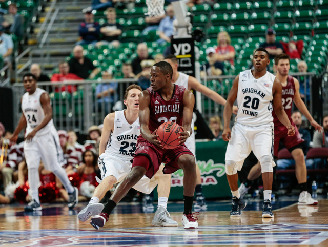 Santa Clara guard Jared Brownridge (23) pauses with the ball while looking around for his team members location, as defender BYU guard Skyler Halford (23) waits for his next move during second hal ...
