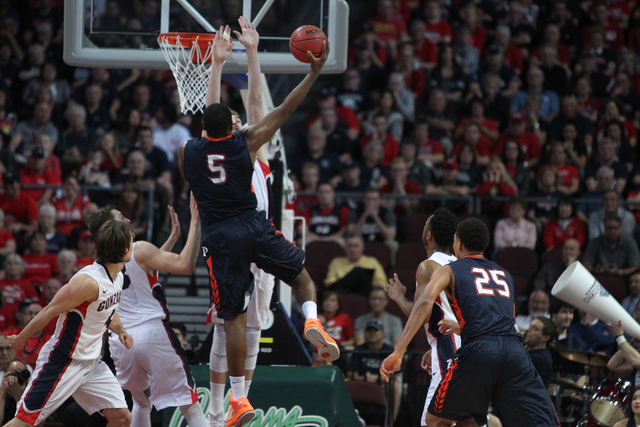 Pepperdine's Stacy Davis (5) goes up for a shot against Gonzaga in the West Coast Conference Basketball Championships semifinal game at the Orleans Arena in Las Vegas Monday, Mach 9, 2015. Gonzaga ...