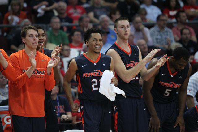 Pepperdine players react to a play from the bench in their game against Gonzaga in the West Coast Conference Basketball Championships semifinal game at the Orleans Arena in Las Vegas Monday, Mach  ...