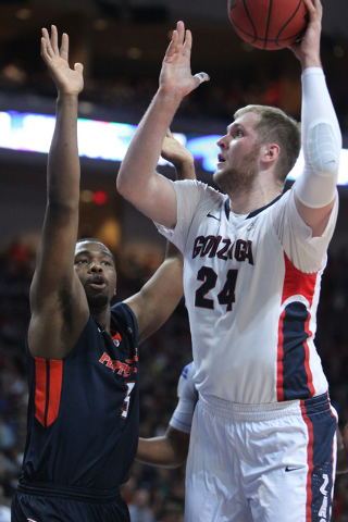 Gonzaga's Przemek Karnowski (24) goes up for a shot against Pepperdine's Jeremy Major (3) in the West Coast Conference Basketball Championships semifinal game at the Orleans Arena in Las Vegas Mon ...
