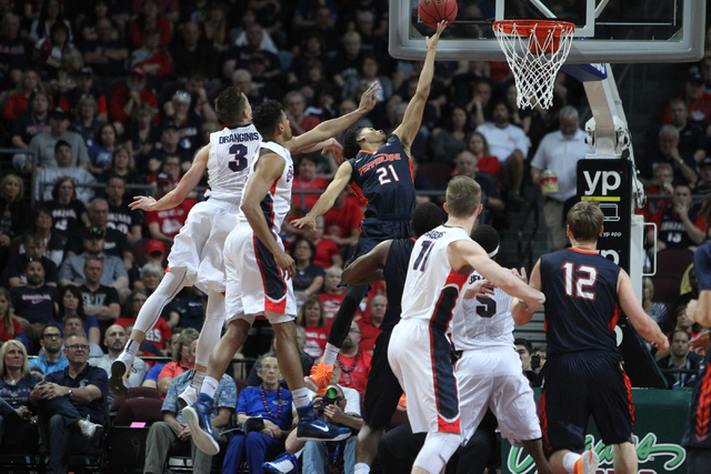 Pepperdine's Shawn Olden (21) goes up for a shot against Gonzaga in the West Coast Conference Basketball Championships semifinal game at the Orleans Arena in Las Vegas Monday, Mach 9, 2015. Gonzag ...