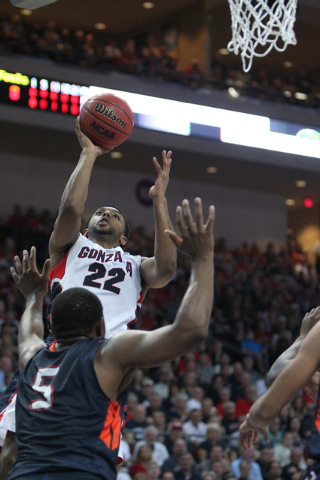 Gonzaga's Byron Wesley (22) goes up for a shot against Pepperdine's Stacy Davis (5) in the West Coast Conference Basketball Championships semifinal game at the Orleans Arena in Las Vegas Monday, M ...