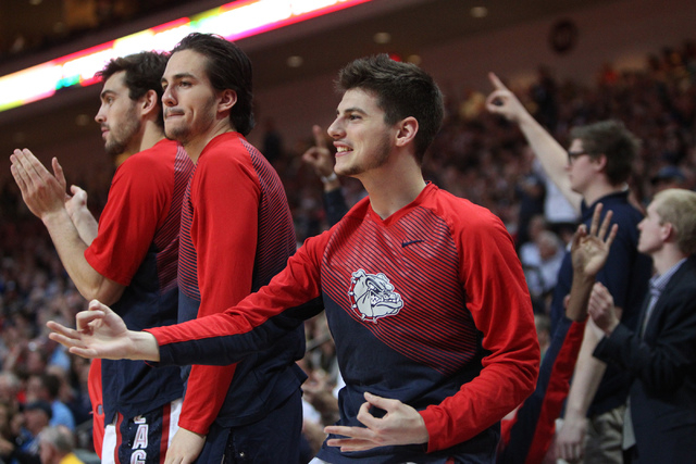 Gonzaga's players react to a play from the bench against Pepperdine in the West Coast Conference Basketball Championships semifinal game at the Orleans Arena in Las Vegas Monday, Mach 9, 2015. Gon ...