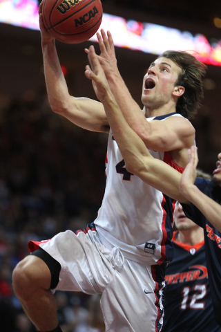 Gonzaga's Kevin Pangos (4) goes up for a shot against Pepperdine in the West Coast Conference Basketball Championships semifinal game at the Orleans Arena in Las Vegas Monday, Mach 9, 2015. Gonzag ...