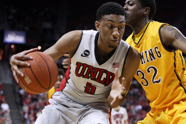 Wyoming forward Alan Herndon defends UNLV forward Chris Wood during the second half of their Mountain West Conference game Saturday, Feb. 28, 2015, at the Thomas & Mack Center.  UNLV won the game  ...