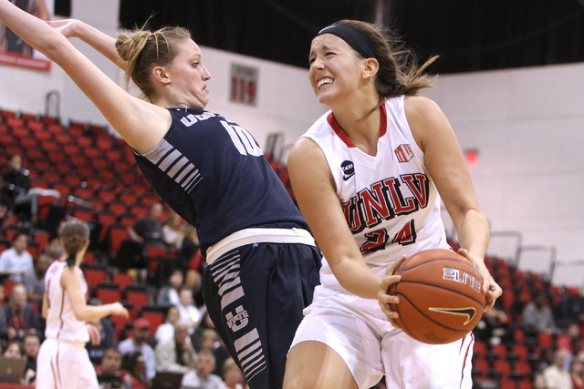 Utah State guard Julianne Anchling fouls UNLV forward Alana Cesarz during the second half of their Mountain West Conference game Wednesday, Feb. 25, 2015 at Cox Pavilion. UNLV won the game 69-61.  ...