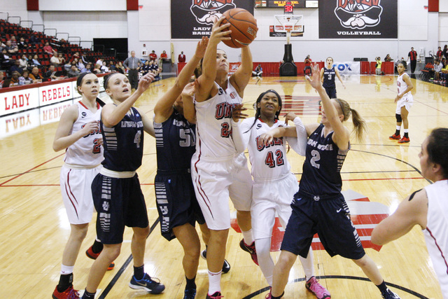 UNLV forward Alana Cesarz grabs a rebound against Utah State during the first half of their Mountain West Conference game Wednesday, Feb. 25, 2015 at Cox Pavilion. Also in on the play are, from le ...