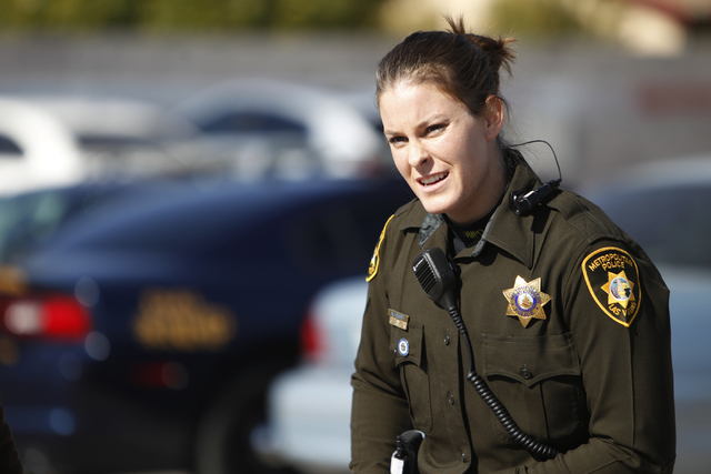 Las Vegas police officer Nicole Hemsey gets ready for a role play a police traffic stop scenario during a presentation of the department's body cameras for the media at the Mojave Training Center  ...