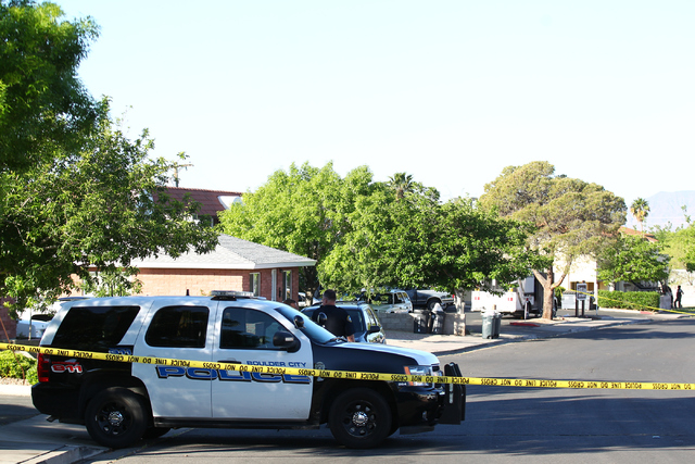 Las Vegas and Boulder City police investigate the scene of an officer-involved shooting at Fifth Street and Avenue A in Boulder City, Nev. on March 30, 2015. (Chase Stevens/Las Vegas Review-Journal)