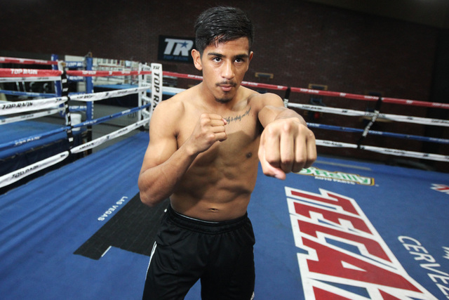 Super bantamweight boxer Jessie Magdaleno shadow boxes during a media availability Thursday, Jan. 8, 2015, at Top Rank gym in advance of his title bout against Erik Ruiz on Saturday. (Sam Morris/L ...