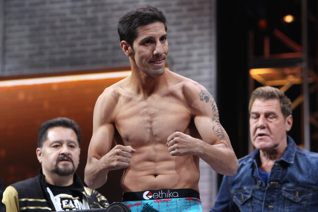 John Molina flexes during weigh ins Friday, March 6, 2015, at the MGM Grand Garden Arena in advance of his Premier Boxing Champions bout against Adrien Broner on Saturday. (Sam Morris/Las Vegas Re ...