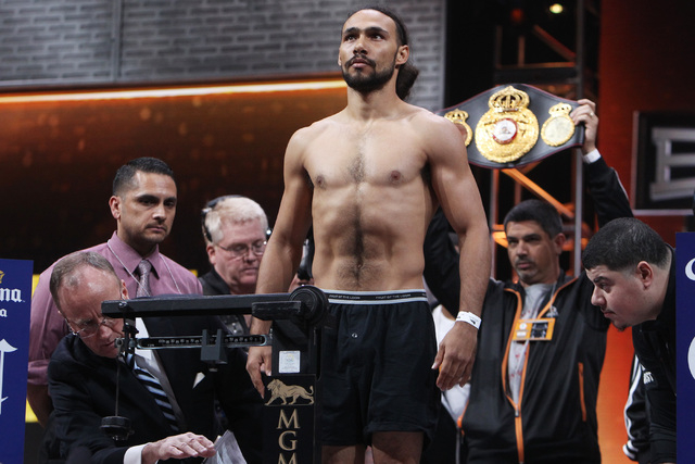 WBA welterweight champion Keith Thurman stands on the scale during weigh ins Friday, March 6, 2015, at the MGM Grand Garden Arena in advance of their Premier Boxing Champions bout against Robert G ...