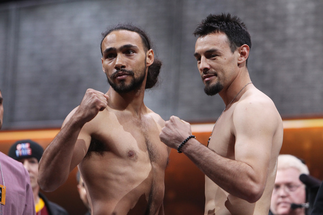 WBA welterweight champion Keith Thurman, left, and Robert Guerrero pose during weigh ins Friday, March 6, 2015, at the MGM Grand Garden Arena in advance of their Premier Boxing Champions bout on S ...