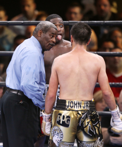 Adrien Broner sticks his tongue out at John Molina as referee Robert Byrd gives them both a warning during their super lightweight fight Saturday, March 7, 2015 at the MGM Grand Garden Arena. Bron ...