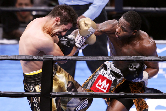 Adrien Broner hits John Molina with a right during their super lightweight fight Saturday, March 7, 2015 at the MGM Grand Garden Arena. Broner won by unanimous decision. (Sam Morris/Las Vegas Revi ...