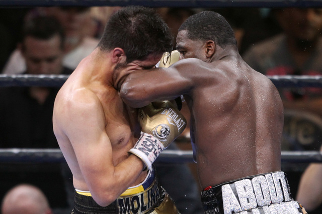 Adrien Broner hits John Molina with a forearm during their super lightweight fight Saturday, March 7, 2015 at the MGM Grand Garden Arena. Broner won by unanimous decision. (Sam Morris/Las Vegas Re ...