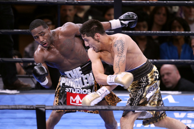 Adrien Broner ducks a shot by John Molina during their super lightweight fight Saturday, March 7, 2015 at the MGM Grand Garden Arena. Broner won by unanimous decision. (Sam Morris/Las Vegas Review ...