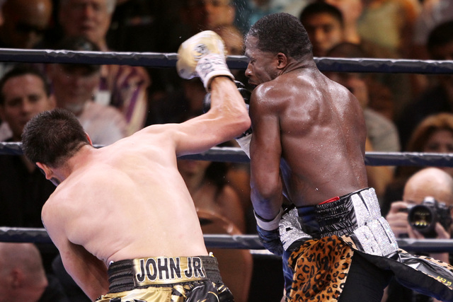 John Molina hits Adrian Broner with a right during their super lightweight fight Saturday, March 7, 2015 at the MGM Grand Garden Arena. Broner won by unanimous decision. (Sam Morris/Las Vegas Revi ...