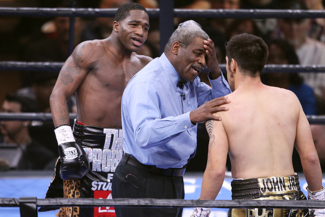 Referee Robert Byrd warns John Molina about head butts as Adrian Broner looks on during their super lightweight fight Saturday, March 7, 2015 at the MGM Grand Garden Arena. Broner won by unanimous ...