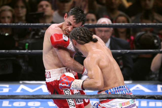 Champion Keith Thurman hits Robert Guerrero with a right during their WBA welterweight title fight Saturday, March 7, 2015 at the MGM Grand Garden Arena. Thurman won by unanimous decision. (Sam Mo ...