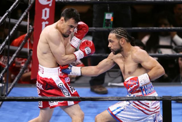 Keith Thurman hits Robert Guerrero with a right to the body during their WBA welterweight title fight Saturday, March 7, 2015 at the MGM Grand Garden Arena. Thurman won by unanimous decision. (Sam ...