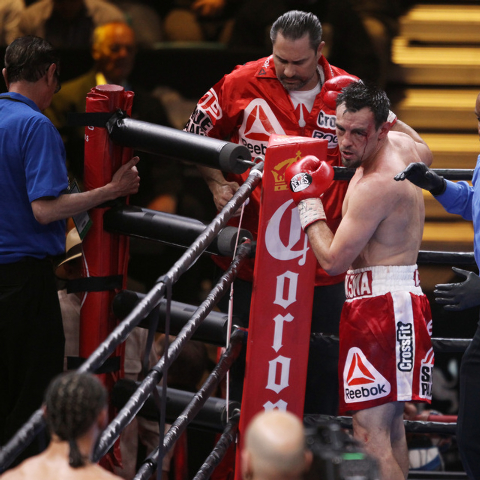 Robert Guerrero looks back at champion Keith Thurman while he gets his glove retyped during their WBA welterweight title fight Saturday, March 7, 2015 at the MGM Grand Garden Arena. Thurman won by ...