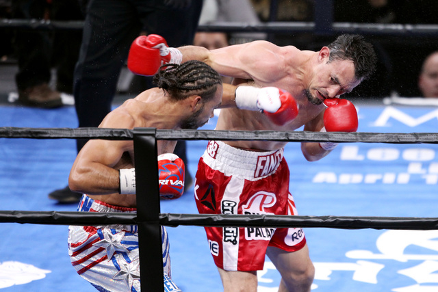 Champion Keith Thurman, left, and Robert Guerrero trade punches during their WBA welterweight title fight Saturday, March 7, 2015 at the MGM Grand Garden Arena. Thurman won by unanimous decision.  ...