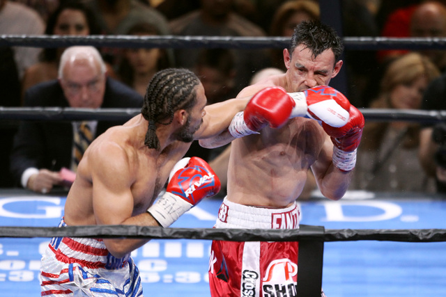 Champion Keith Thurman hits Robert Guerrero with a left during their WBA welterweight title fight Saturday, March 7, 2015 at the MGM Grand Garden Arena. Thurman won by unanimous decision. (Sam Mor ...