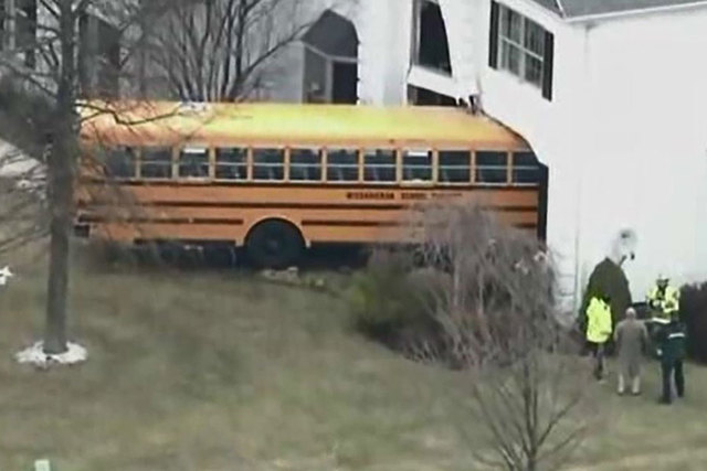 A school bus carrying students crashed into a Philadelphia-area home Tuesday morning, March 24, 2015. (Screengrab/WPXI)