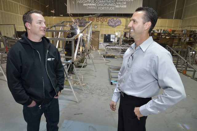 Greg Pancirov, vice president for Colliers International industrial division, right, talks with tenant Tony Lamecker, president of Stage House, which handles custom staging and scenery, in part of ...