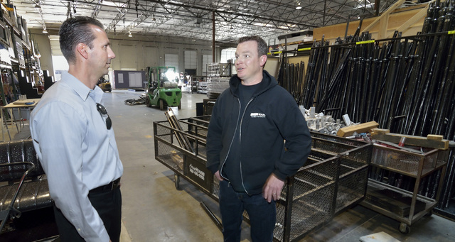 Greg Pancirov, vice president for Colliers International industrial division, left, talks with tenant Tony Lamecker, president of Stage House, which handles custom staging and scenery, in part of  ...