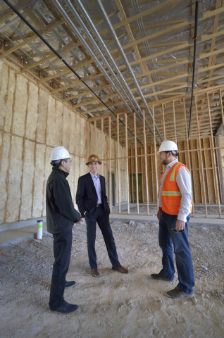 John Woo, vice president of asset management for Equity Office, center, talks with Cesar Shih, left, and Chris Chebegia on the construction site of a 12,000-square-foot retail center on the northw ...
