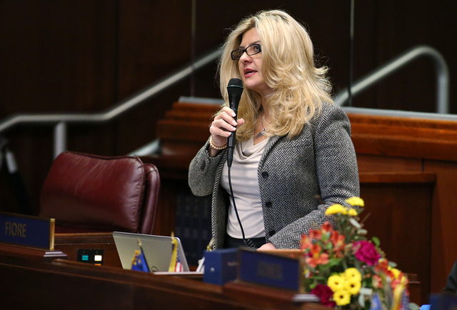 Nevada Assemblywoman Michele Fiore, R-Las Vegas, introduces a bill on the Assembly floor at the Legislative Building in Carson City, Nev., on Friday, Feb. 13, 2015. (Cathleen Allison/Las Vegas Rev ...