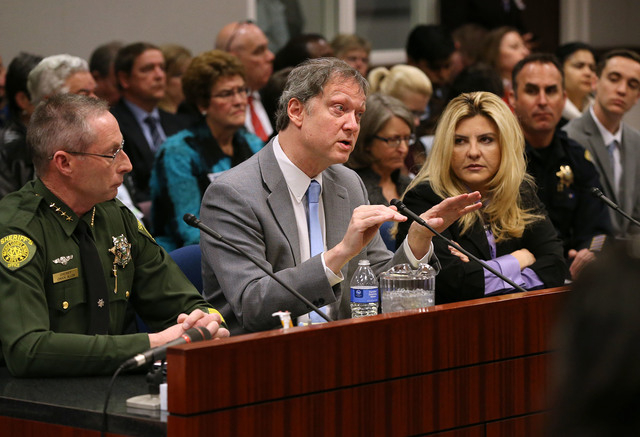 Washoe County Sheriff Chuck Allen, left, John Lott, an academic and president of an organization called the Crime Prevention Research Center, and Assemblywoman Michele Fiore, R-Las Vegas, urge law ...