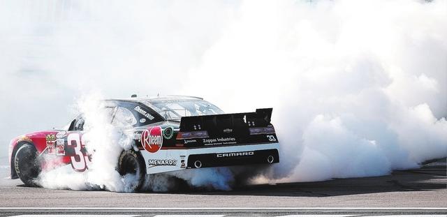 Race winner Austin Dillon (33) performs a burnout after winning the NASCAR Xfinity Series Boyd Gaming 300 at Las Vegas Motor Speedway in Las Vegas, Saturday, March 7, 2015.(Josh Holmberg/Las Vegas ...