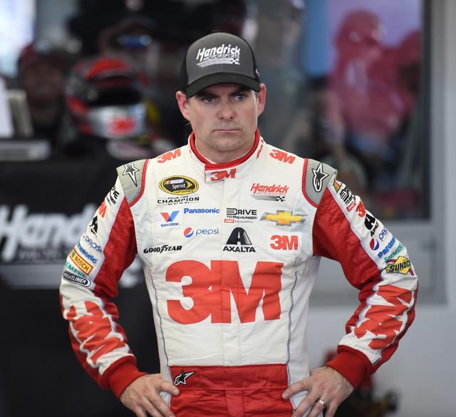 An angry Jeff Gordon is seen in the garage after he hit the wall in the final practice session for the Kobalt 400 NASCAR Sprint Cup Series auto race at Las Vegas Motor Speedway in Las Vegas, Satur ...