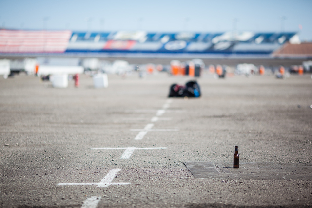 A lone beer bottle is seen on the ground in the infield RV lot the day after the NASCAR Sprint Cup Series Kobalt 400 race at the Las Vegas Motor Speedway on Monday, March 9, 2015. (Chase Stevens/L ...