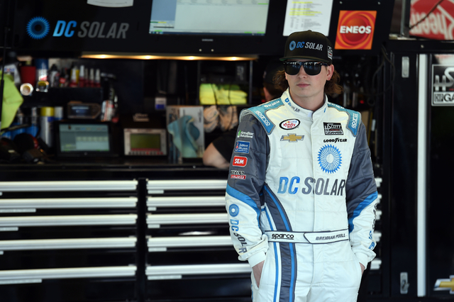 NASCAR driver Brennan Poole waits in his garage before a practice session at Las Vegas Motor Speedway on Friday, March 6, 2015. (Josh Holmberg/Las Vegas Review Journal)