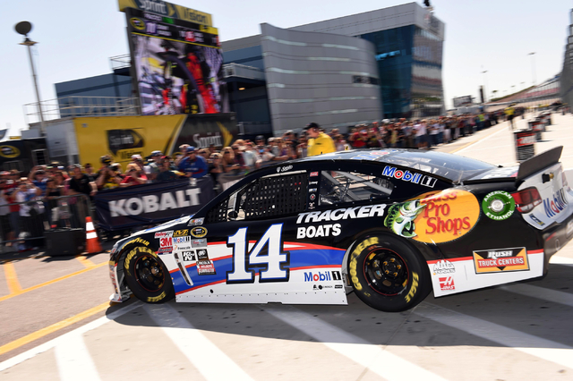 NASCAR Sprint Cup Series driver Tony Stewart drives past fans while returning to the garage in the first practice session during Stratosphere Pole Day at Las Vegas Motor Speedway on Friday, March  ...