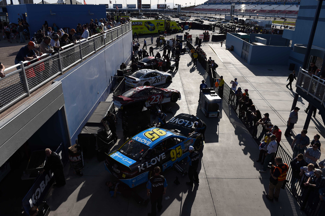 NASCAR Sprint Cup fans watch watch the inspection process in the Neon Garage during qualifying for the Kobalt 400 at Las Vegas Motor Speedway on Friday, March 6, 2015. (Josh Holmberg/Las Vegas Rev ...